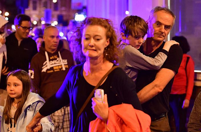 <p>People run down Borough High Street as police are dealing with an incident on London Bridge in London, Saturday, June 3, 2017. Transport for London Says London Bridge closed in both directions due to police activity. (Dominic Lipinski/PA via AP) </p>