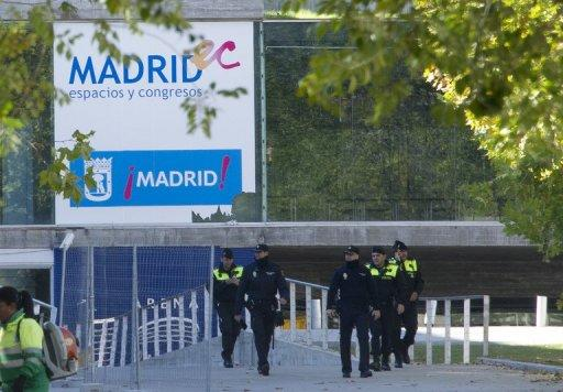 Spanish police officers walk near the entrance to the Madrid Arena stadium in Madrid on November 1, 2012