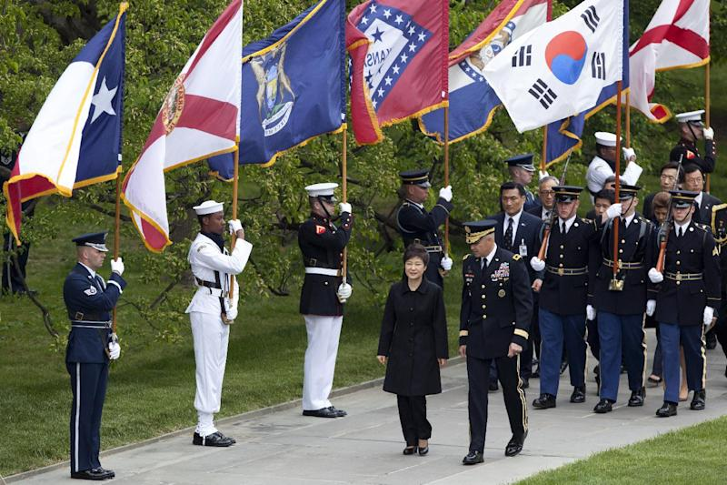 Visiting South Korea President Park Geun-hye, center left, is escorted by Maj. Gen. Michael Linnington, as they march past the colors of American states, during a wreath laying ceremony at the Tomb of the Unknowns at Arlington National Cemetery in Arlington, Va., Monday, May 6, 2013. (AP Photo/Manuel Balce Ceneta)