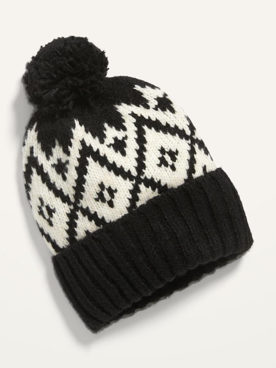 <p>This <span>Old Navy Cozy Pom-Pom Sweater Beanie</span> ($11, originally $13) is perfect for the holidays.</p>