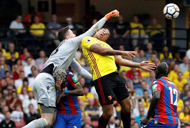 "Soccer Football - Premier League - Watford v Crystal Palace - Vicarage Road, Watford, Britain - April 21, 2018 Crystal Palace's Wayne Hennessey punches clear of Watford's Troy Deeney Action Images via Reuters/Paul Childs EDITORIAL USE ONLY. No use with unauthorized audio, video, data, fixture lists, club/league logos or ""live"" services. Online in-match use limited to 75 images, no video emulation. No use in betting, games or single club/league/player publications. Please contact your account representative for further details. TPX IMAGES OF THE DAY"