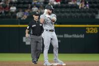 Chicago White Sox's Romy Gonzalez (5) gestures to the dugout as he celebrates his RBI double during the second inning of the team's baseball game against the Texas Rangers, as umpire Mark Wegner stands nearby in Arlington, Texas, Friday, Sept. 17, 2021. (AP Photo/Tony Gutierrez)
