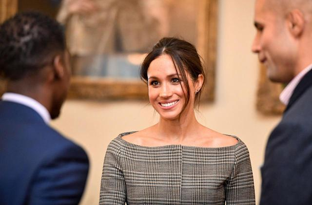 <p>Meghan Markle wears a checkered off-the-shoulder jacket by Theory while visiting Cardiff, Wales. (Photo: Getty Images) </p>