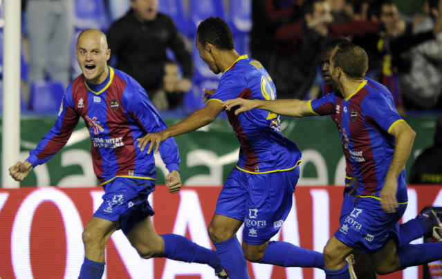Levante's defender Nano (L) celebrates with teammates after scoring during the Spanish league football match Levante UD vs Sevilla on December 10,2011 at Ciutat de Valencia stadium in Valencia.AFP PHOTO/ JOSE JORDAN (Photo credit should read JOSE JORDAN/AFP/Getty Images)