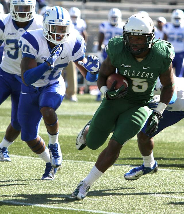 UAB running back Darrin Reaves (5) gets by Middle Tennessee State linebacker Stephen Roberts (30) and runs in for a touchdown during the first half of an NCAA college football game on Saturday, Nov. 1, 2013, in Birmingham, Ala. (AP Photo/Butch Dill)