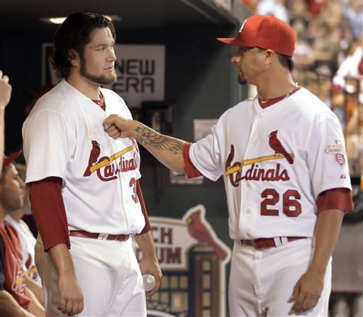 St. Louis Cardinals starting pitcher Lance Lynn, left, is congratulated by Kyle Lohse after being pulled out of a baseball game against the Pittsburgh Pirates during the seventh inning Wednesday, May 2, 2012, in St. Louis. Lynn gave up two runs on three hits. (AP Photo/Jeff Roberson)