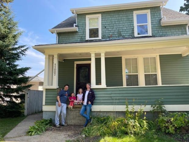 The Armhein family in front of their home before the renovation work began. (Kyla Armhein/supplied - image credit)