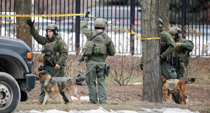 Pictured are authorities in camouflage at the scene of the Milwaukee shooting.