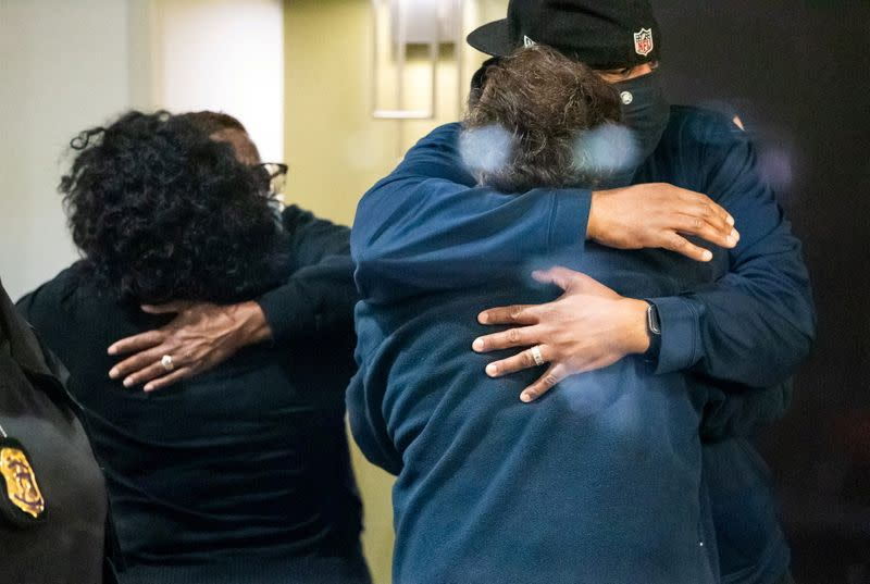 FILE PHOTO: People embrace after learning that their loved one was safe after a mass casualty shooting at the FedEx facility in Indianapolis