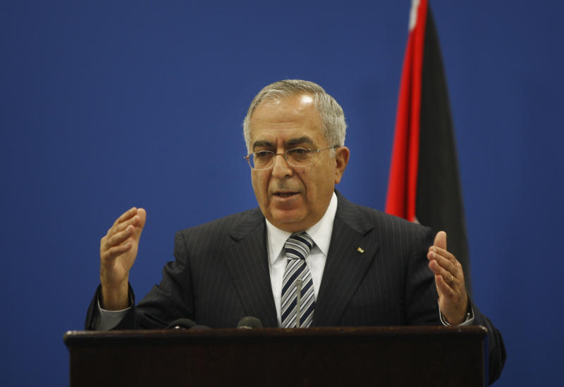 Palestinian Prime Minister Salam Fayyad holds a press conference in the West Bank city of Ramallah, Tuesday, Sept. 11, 2012. As part of his efforts to calm the growing unrest in the West Bank over the high cost of living, Fayyad on Tuesday said the Palestinian Authority will decrease fuel prices and cut salaries of top officials. (AP Photo/Majdi Mohammed)