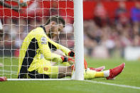 Manchester United's goalkeeper David de Gea reacts after Aston Villa's Kortney Hause scored his side's opening goal during the English Premier League soccer match between Manchester United and Aston Villa at the Old Trafford stadium in Manchester, England, Saturday, Sept 25, 2021. (AP Photo/Jon Super)