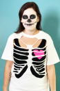 """<p>Halloween and skeletons go together like no other. The good news is that with a quick makeup look, you can have an impressive costume that takes a minimal amount of effort. To make, cut out sections of a t-shirt to create a ribcage illusion, add some face paint, and stick on a paper heart for an especially adorable skeleton.</p><p><a class=""""link rapid-noclick-resp"""" href=""""https://www.amazon.com/Costumes-Occasions-DD451-Palette-Skeleton/dp/B000LNGBN6?tag=syn-yahoo-20&ascsubtag=%5Bartid%7C10070.g.490%5Bsrc%7Cyahoo-us"""" rel=""""nofollow noopener"""" target=""""_blank"""" data-ylk=""""slk:SHOP FACE PAINT"""">SHOP FACE PAINT</a> </p>"""