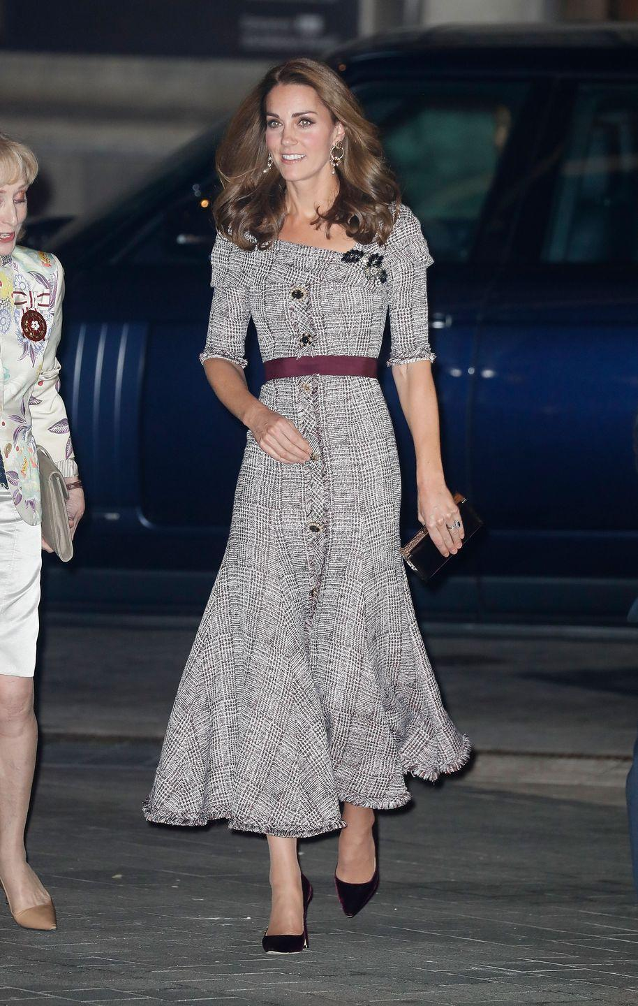 """<p>Kate arrived at the opening of the V&A museum's new photography center wearing a gray plaid dress by Erdem. <a href=""""https://www.townandcountrymag.com/society/tradition/a23695614/kate-middleton-victoria-albert-museum-photography-centre-opening/"""" rel=""""nofollow noopener"""" target=""""_blank"""" data-ylk=""""slk:She paired the look with maroon heels and a boxy clutch."""" class=""""link rapid-noclick-resp"""">She paired the look with maroon heels and a boxy clutch.</a></p>"""
