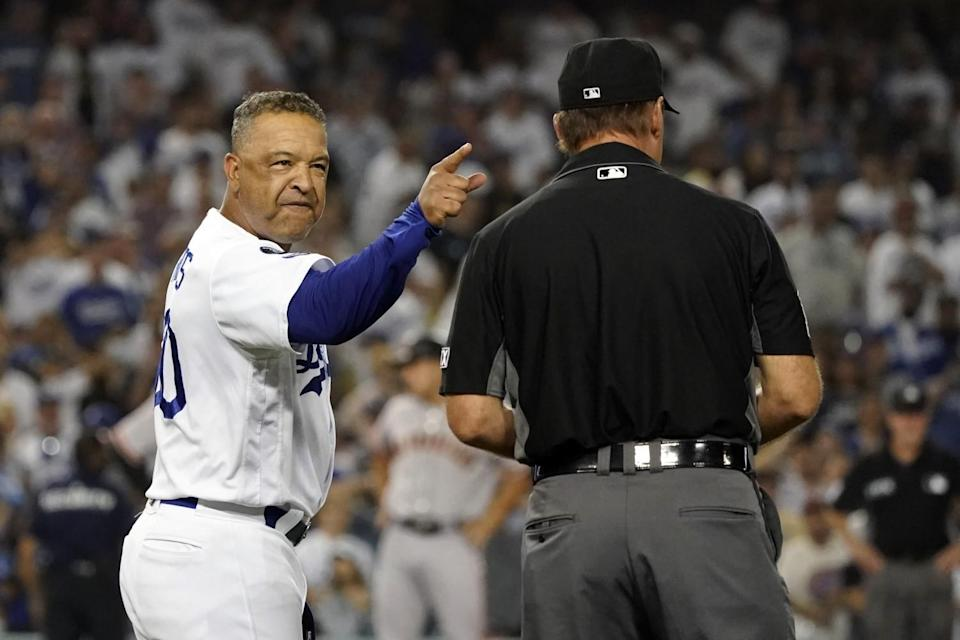 Dodgers manager Dave Roberts argues with first base umpire Ed Hickox in the ninth inning Thursday.