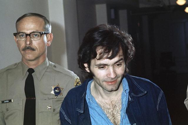 <p>Charles Manson, accused murderer in the Sharon Tate murder case in Los Angeles, is shown clean-shaven and with a haircut, on Nov. 10, 1970. (Photo: AP) </p>
