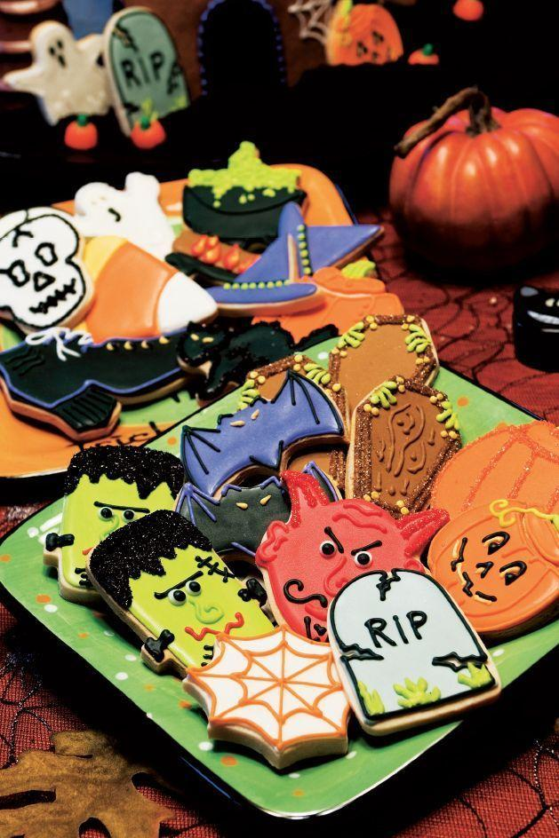 """<p>Want to put your cookie decorating skills to the test? Try replicating this assortment of festive cookies with everything from coffins, to pumpkins, to skulls. </p><p><strong><em><a href=""""https://www.womansday.com/food-recipes/food-drinks/a28861242/decorated-cookies-recipe/"""" rel=""""nofollow noopener"""" target=""""_blank"""" data-ylk=""""slk:Get the Decorated Cookies recipe."""" class=""""link rapid-noclick-resp"""">Get the Decorated Cookies recipe. </a></em></strong></p>"""