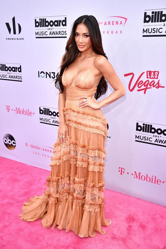 <p>The singer isn't shy in this skin-toned gown. (Photo: Getty Images) </p>