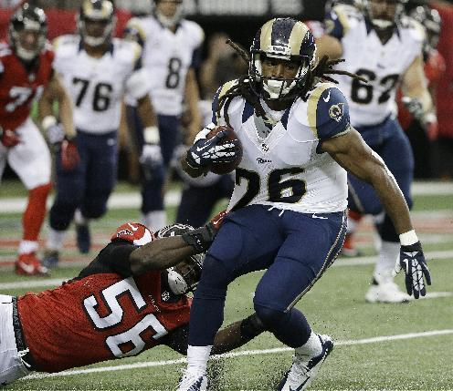 St. Louis Rams running back Daryl Richardson (26) is hit by Atlanta Falcons outside linebacker Sean Weatherspoon (56) during the first half of an NFL football game, Sunday, Sept. 15, 2013, in Atlanta. (AP Photo/David Goldman)