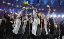 <p>The silver windbreakers paired with drab gray pencil skirts looked dated. This is a summer sporting event — tights aren't necessary!</p><p><i>(Photo: Getty Images)</i></p>