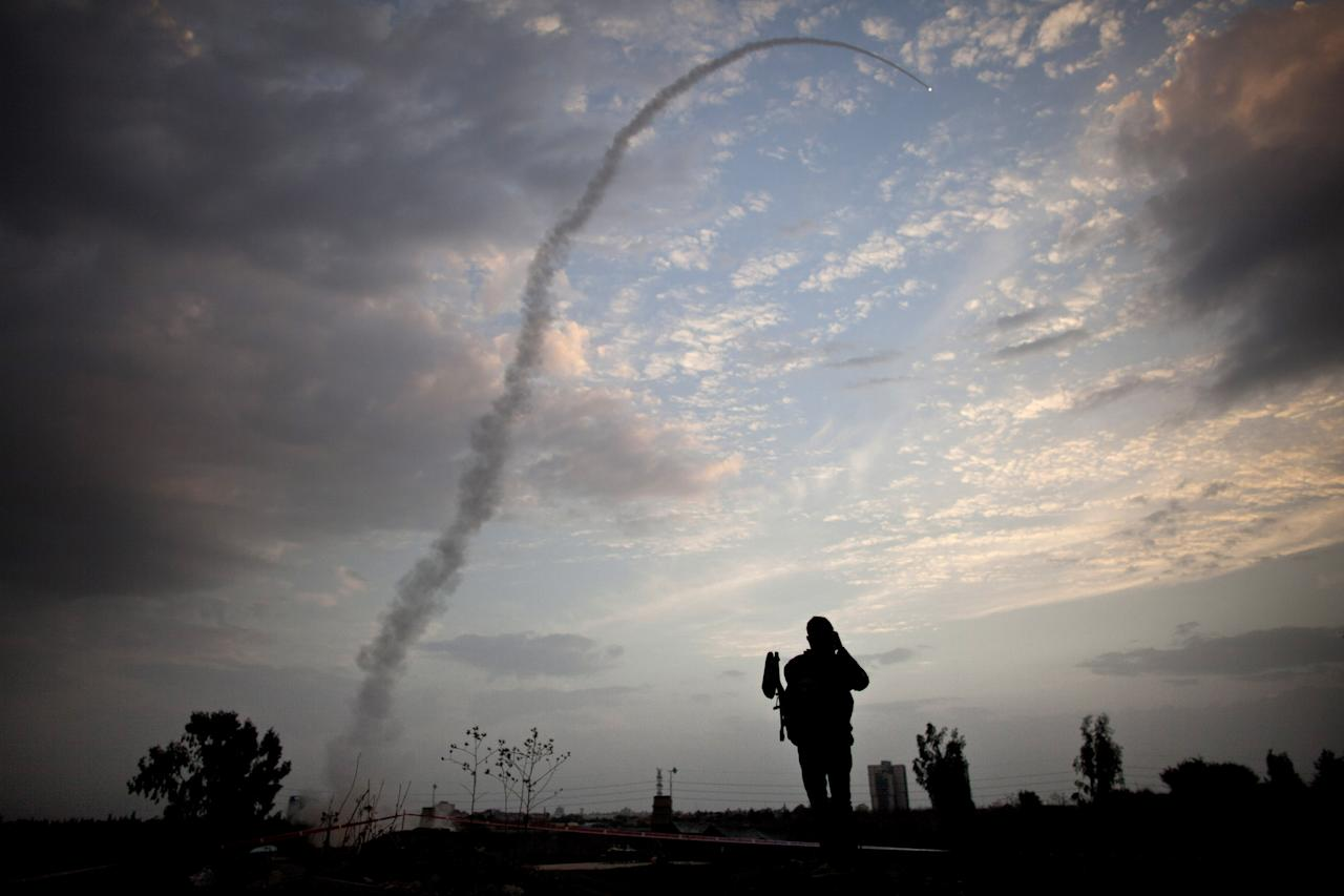TEL AVIV, ISRAEL - NOVEMBER 17: (ISRAEL OUT) An Israeli missile from the Iron Dome defence missile system is launched to intercept and destroy incoming rocket fire from Gaza on November 17, 2012 in Tel Aviv, Israel.  At least 39 Palestinians and three Isreali's have died since conflict began four days ago. Israeli troops have been massing on the border as some 200 targets were hit overnight in Gaza, including Hamas cabinet buildings. (Photo by Uriel Sinai/Getty Images)