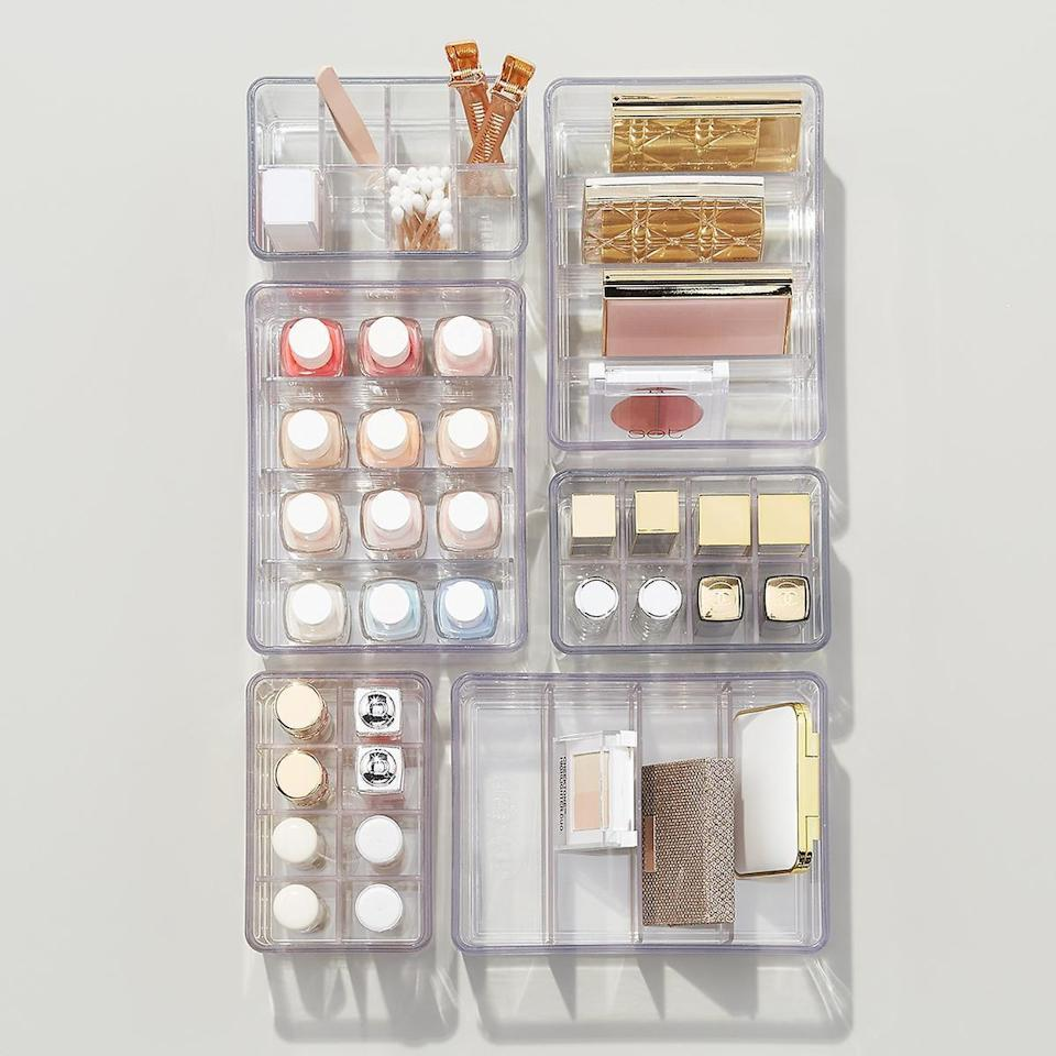 <p>Store all your beauty products in the <span>The Home Edit Clear Bin Dividers</span> ($4-$6).</p>