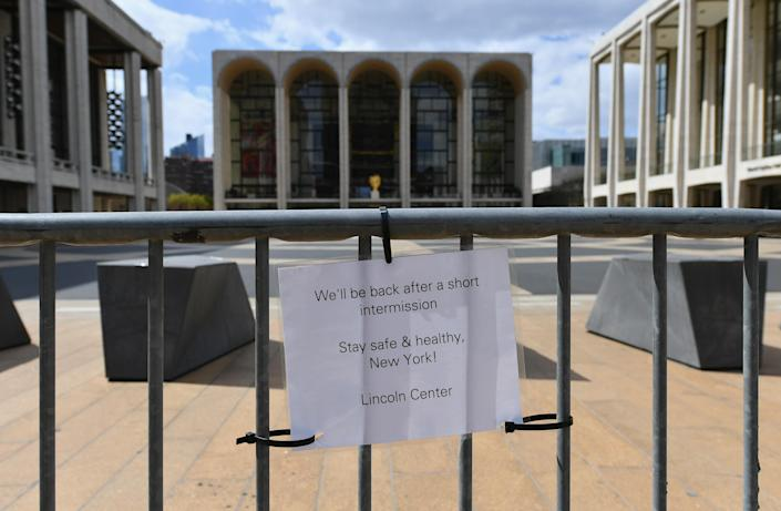 A sign is displayed outside Lincoln Center on April 16, 2020 in New York City. / Credit: ANGELA WEISS/AFP via Getty Images