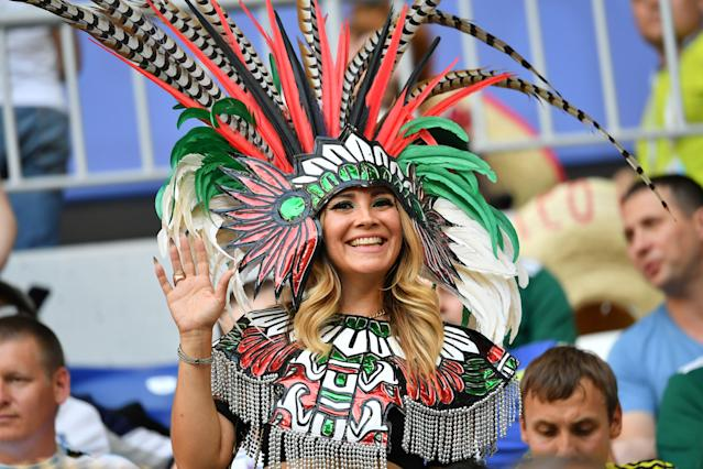 <p>A fan attends the Russia 2018 World Cup round of 16 football match between Brazil and Mexico at the Samara Arena in Samara on July 2, 2018. (Photo by EMMANUEL DUNAND / AFP) </p>