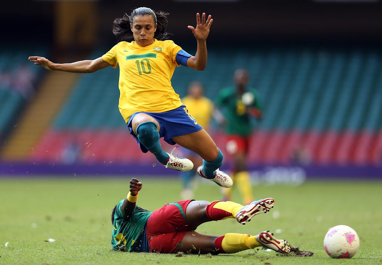 CARDIFF, WALES - JULY 25:  Marta of Brazil is tackled by Christine Manie of Cameroon during the Women's Football first round Group E Match of the London 2012 Olympic Games between Cameroon and Brazil at Millennium Stadium on July 25, 2012 in Cardiff, Wales.  (Photo by Julian Finney/Getty Images)