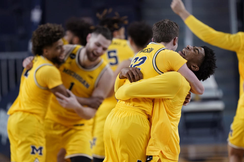 The Michigan bench reacts after winning the Big Ten title against Michigan State in the second half of an NCAA college basketball game, Thursday, March 4, 2021, in Ann Arbor, Mich. (AP Photo/Carlos Osorio)