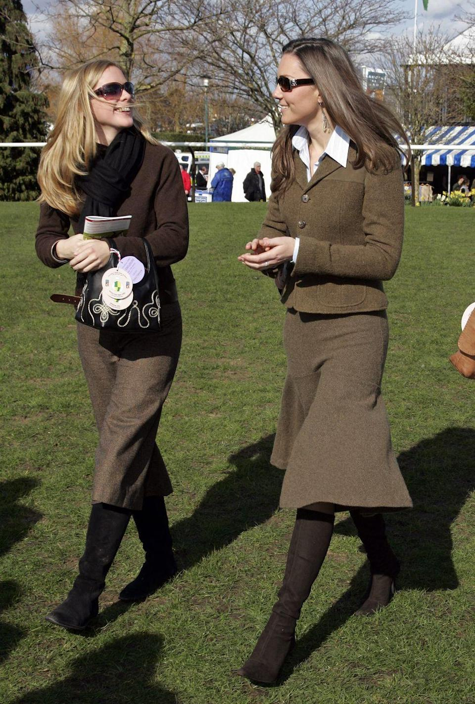 <p>Wearing a tweed skirt suit on the first day of the Cheltenham Horse Racing Festival in Cheltenham, England.<br></p>