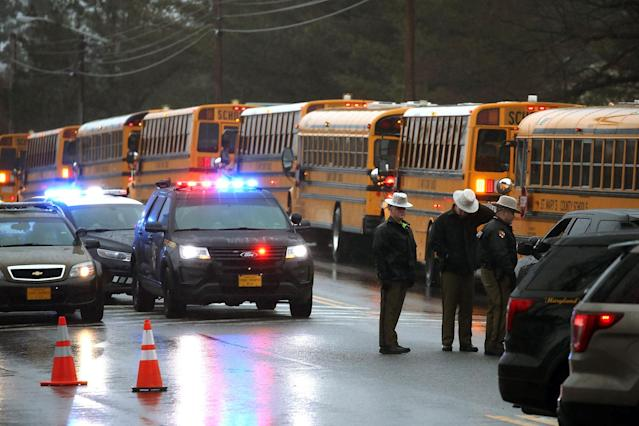 <p>School buses are lined up in front of Great Mills High School after a shooting on March 20, 2018 in Great Mills, Md. (Photo: Mark Wilson/Getty Images) </p>