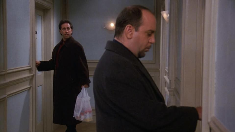 Jerry looks at his neighbor Phil down the hall on Seinfeld