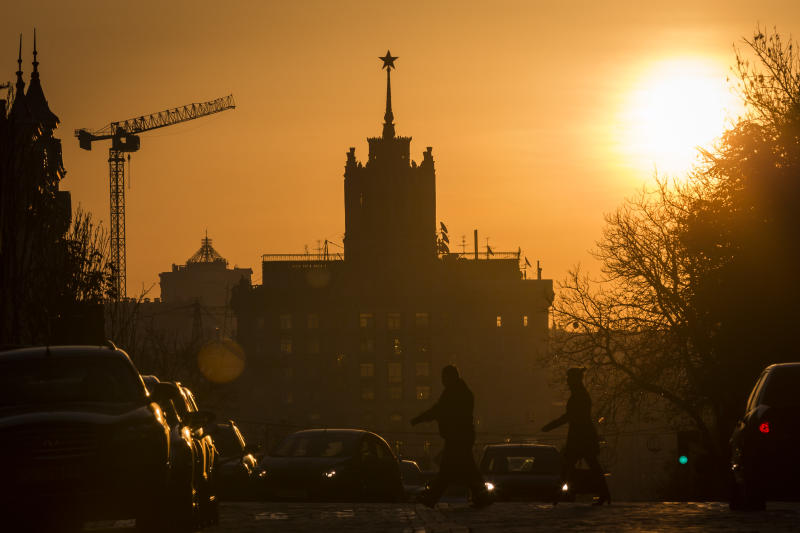 KIEV, UKRAINE - OCTOBER 14: Sunrise in Kiev, the sun is coming up next to a building on October 14, 2014, in Kiev, Ukraine. Photo by Thomas Trutschel/Photothek via Getty Images)***Local Caption***