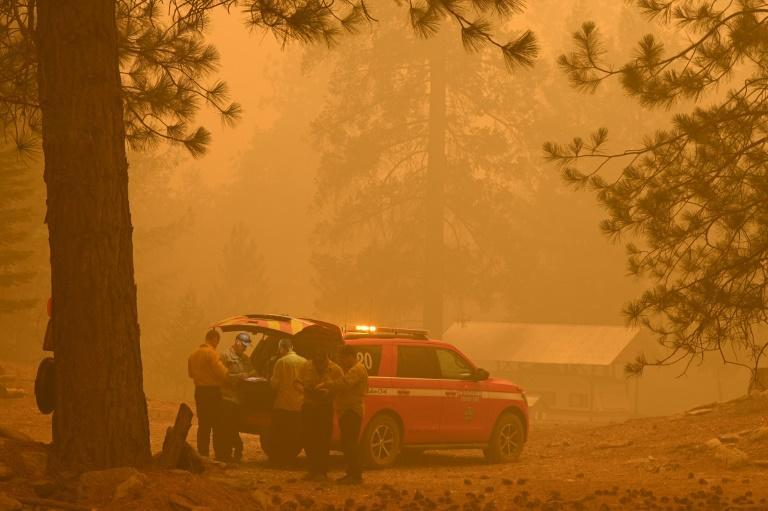 Firefighters plan strategy in the evacuation zone of the Dixie Fire, in Twain, California