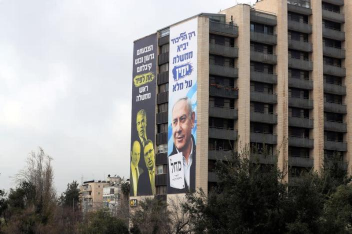 Election campaign posters by Israeli prime minister Benjamin Netanyahu's Likud Party are seen on a building in Jerusalem