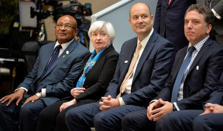 Federal Reserve Board Chairperson Janet Yellen (2nd, L) joins (L-R) African Union Commissioner for Economic Affairs Anthony Mothae Maruping, Argentina's Central Bank Chairman Federico Sturzenegger and Argentina's Treasury Minister Nicolas Dujovne, posing with ministers and bank governors for a family photo during the IMF and World Bank's 2017 Annual Spring Meetings, in Washington, U.S., April 21, 2017.      REUTERS/Mike Theiler