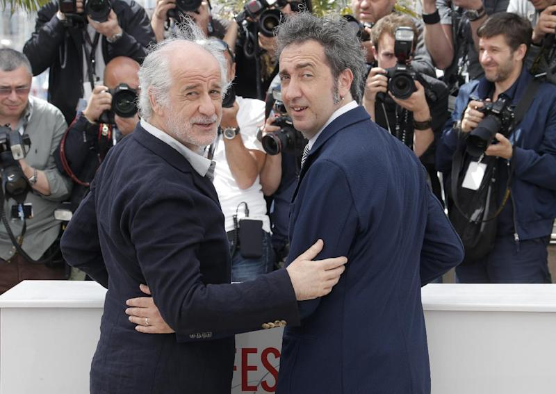 Director Paolo Sorrentino, right, and Toni Servillo pose for photographers during a photo call for the film The Great Beauty at the 66th international film festival, in Cannes, southern France, Tuesday, May 21, 2013. (Photo by Todd Williamson/Invision/AP)