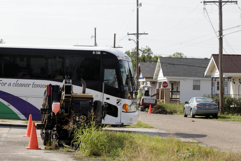 A tour bus turns a corner in the Lower 9th Ward section of New Orleans, Tuesday, Oct. 2, 2012. Residents and the City of New Orleans may be pushing back against tour companies ushering out-of-towners into to the Lower 9th Ward, the neighborhood made famous when floodwalls and levees failed in 2005, pushing homes off their foundations and stranding residents on rooftops. (AP Photo/Gerald Herbert)