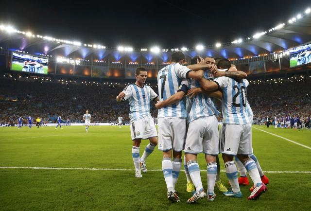 Argentina's Lionel Messi is congratulated by his teammates after scoring a goal against Bosnia during their 2014 World Cup Group F soccer match at the Maracana stadium in Rio de Janeiro June 15, 2014. REUTERS/Michael Dalder (BRAZIL - Tags: SOCCER SPORT WORLD CUP)