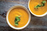 """To give this velvety carrot soup a tiny bit of crunch and extra visual appeal, chia seeds are stirred in after the soup is pureed. <a href=""""https://www.epicurious.com/recipes/food/views/creamy-chia-coconut-ginger-carrot-soup-51250210?mbid=synd_yahoo_rss"""" rel=""""nofollow noopener"""" target=""""_blank"""" data-ylk=""""slk:See recipe."""" class=""""link rapid-noclick-resp"""">See recipe.</a>"""
