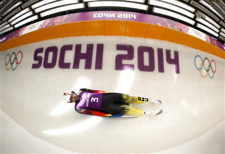 Germany's Andi Langenhan speeds down the track during a men luge training at the Sanki sliding center in Rosa Khutor, a venue for the 2014 Sochi Winter Olympics near Sochi