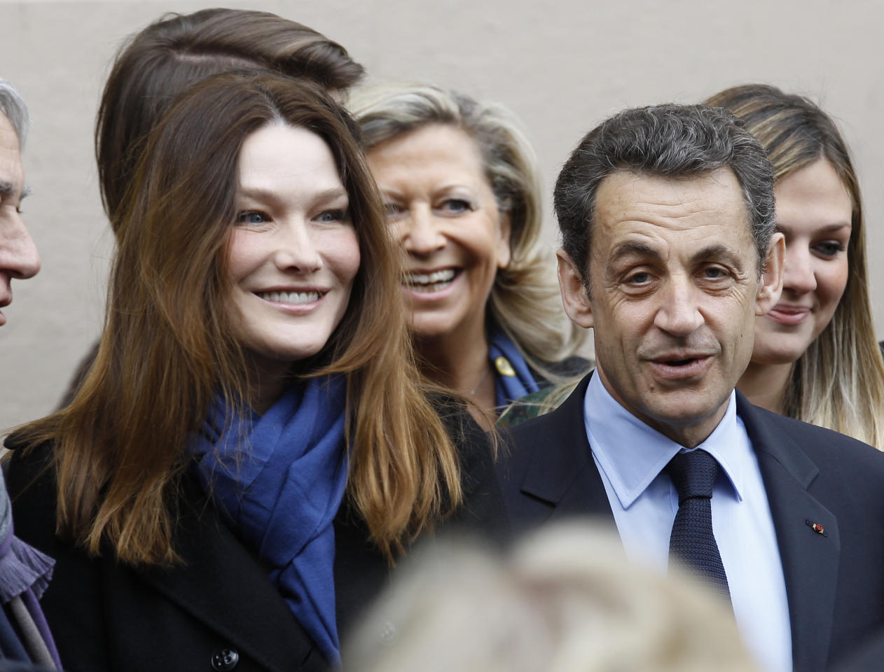 French President and UMP candidate Nicolas Sarkozy and his wife Carla Bruni-Sarkozy leave after casting their votes in the first round of French presidential elections in Paris, France, Sunday, April 22, 2012. (AP Photo/Remy de la Mauviniere)
