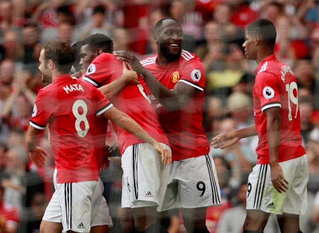 Romelu Lukaku celebrates with teammates after scoring the second goal