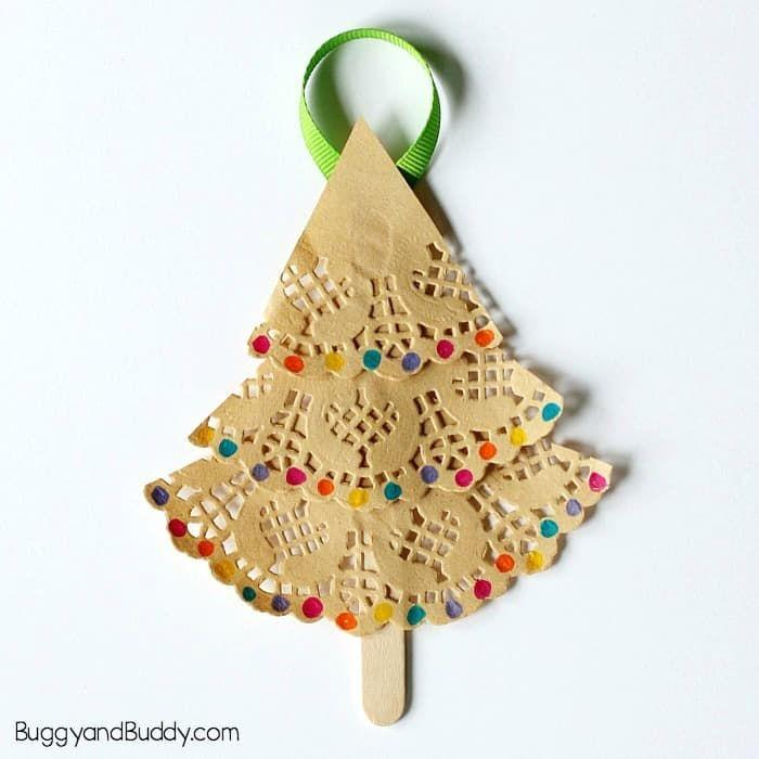 """<p>Paper doilies and craft sticks form the basis of this easy project with a pretty, delicate result. Cut the doilies into triangles, and glue them to the sticks, letting the kids decorate their trees as they wish. Hang them using colorful ribbon.</p><p><em><a href=""""https://buggyandbuddy.com/christmas-tree-ornament-craft-kids-doilies/"""" rel=""""nofollow noopener"""" target=""""_blank"""" data-ylk=""""slk:Get the tutorial at Buggy and Buddy"""" class=""""link rapid-noclick-resp"""">Get the tutorial at Buggy and Buddy</a></em><br></p>"""