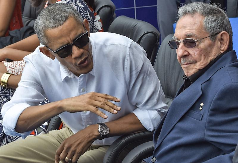 US President Barack Obama speaks next to Cuban President Raul Castro (R) during a Major League baseball exhibition game at the Latinoamericano stadium in Havana (AFP Photo/Nicholas Kamm)