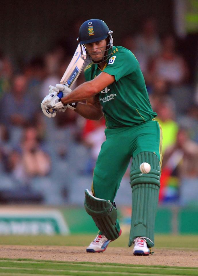 EAST LONDON, SOUTH AFRICA - DECEMBER 23:   far du Plessis of South Africa about to drive a delivery during the 2nd T20 match between South Africa and New Zealand at Buffalo Park on December 23, 2012 in East London, South Africa.  (Photo by Duif du Toit/Gallo Images/Getty Images)