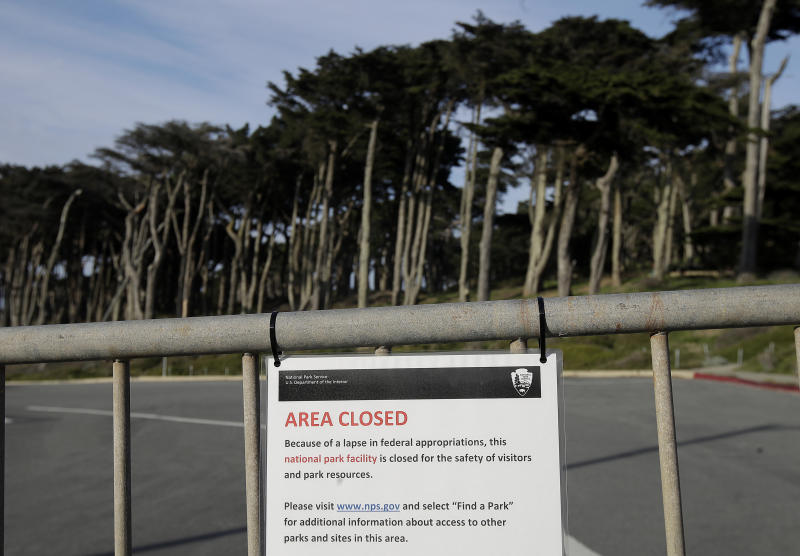 A sign is posted on a gate blocking a parking lot to Land's End in San Francisco, Thursday, Jan. 3, 2019. Nonprofits, businesses and state governments across the country are paying bills and putting in volunteer hours in an uphill battle to keep national parks safe and clean for visitors as the partial U.S. government shutdown lingers. (AP Photo/Jeff Chiu)