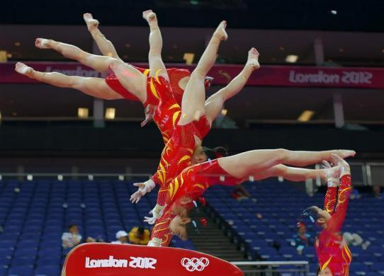 Huang Qiushuang of China attends a gymnastics training session at the North Greenwich Arena before the start of the London 2012 Olympic Games July 26, 2012.