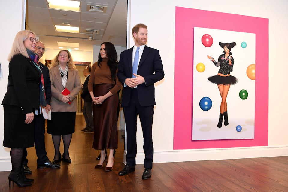 LONDON, UNITED KINGDOM - JANUARY 07: Prince Harry, Duke of Sussex and Meghan, Duchess of Sussex stand with High Commissioner for Canada in the United Kingdom, Janice Charette (C) as they view a special exhibition of art by Indigenous Canadian artist, Skawennati, in the Canada Gallery during their visit to Canada House in thanks for the warm Canadian hospitality and support they received during their recent stay in Canada, on January 7, 2020 in London, England. (Photo by DANIEL LEAL-OLIVAS  - WPA Pool/Getty Images)