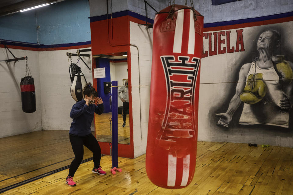Cristina Pastor, wearing face masks to prevent the spread of the coronavirus, exercises at a boxing gym in the southern neighbourhood of Vallecas in Madrid, Spain, Monday, Sept. 28, 2020. (AP Photo/Bernat Armangue)